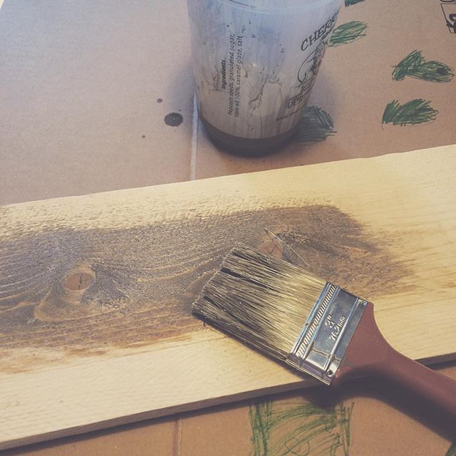 This faux barnwood painting technique looks amazing in this rustic kitchen!