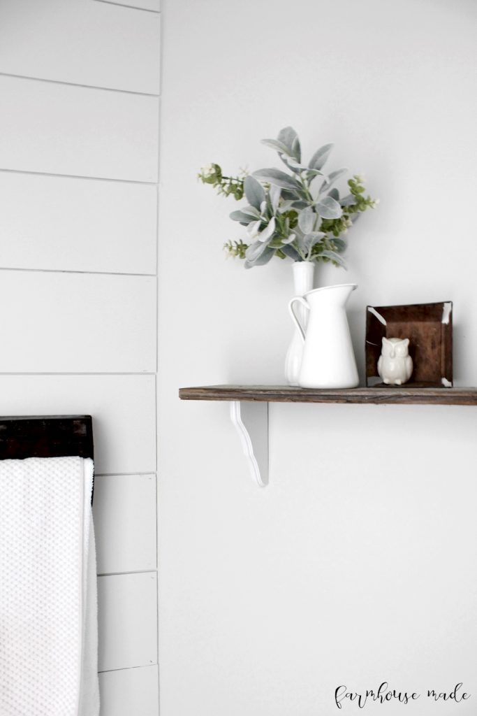 Adding salvaged barn wood is a great way to add character to a farmhouse style powder room! This one was literally $100!