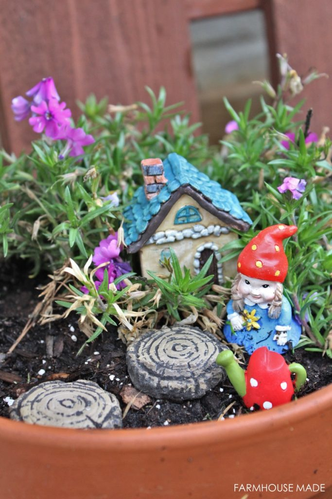 A DIY Fairy Garden made from a salvaged bird bath - this is crazy adorable. The flowers are so cute and I love the little house! My kids would love this, making it for sure!