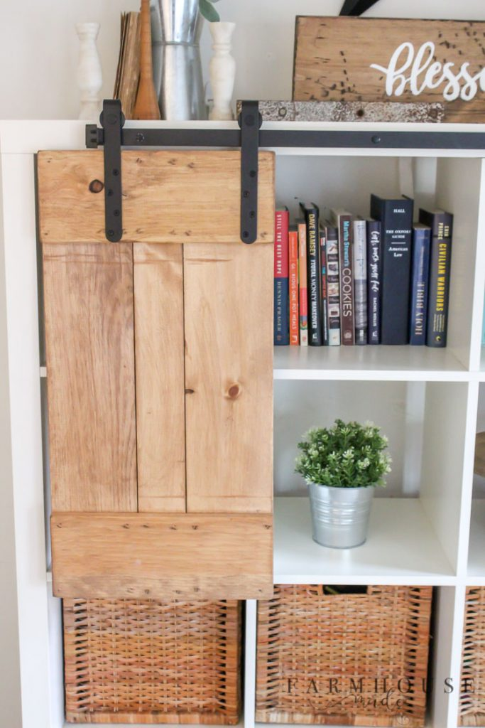 These oil rubbed bronze farmhouse style mini sliding barn doors are the perfect way to conceal clutter, both visual and actual!