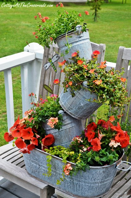 How gorgeous is this topsy turvy galvanized bucket planter!? This one is the perfect addition to any garden!