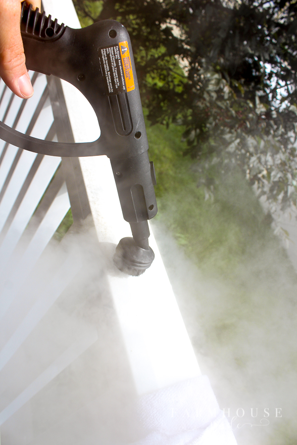 HomeRight SteamMachine cleaning dirt on white vinyl railings