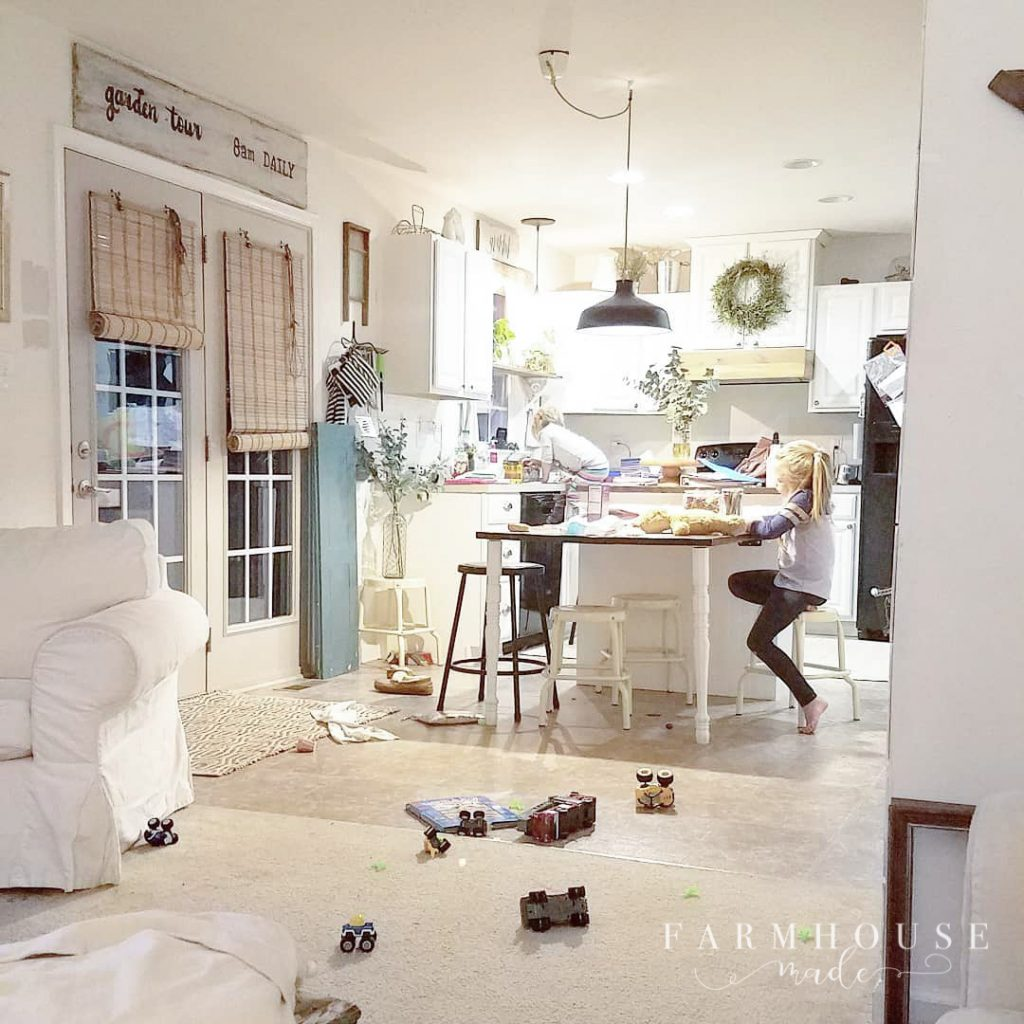 cluttered farmhouse kitchen with kids