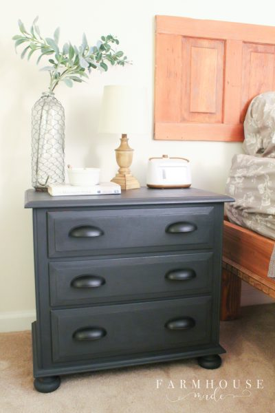 Spraying Chalk-Style Paint on nightstand